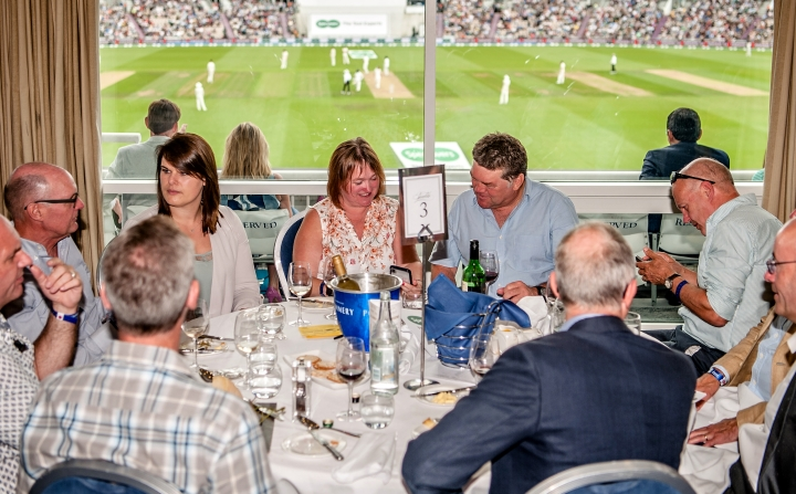 A group of guests entertained and enjoying the panoramic views from the Robin Smith Suite