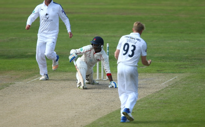 Taylor celebrates after taking a wicket in Hampshire's County Championship clash with Lancashire in 2017