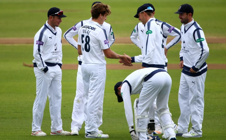 Wheal is congratulated by his team-mates after picking up a wicket in the 2017 County Championship